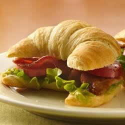 BLT Crescent Sandwiches Recipe - This is not your ordinary BLT. Adding guacamole and building the sandwich on a fresh-baked Crescent makes this 30-minute meal a real stand-out.