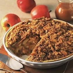 Caramel Cream Apple Crunch Pie Recipe - Filled with creamy caramel apples and sprinkled with an almond and gingersnap crumb topping, this is a rich, decadent twist on apple pie.
