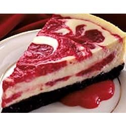 Cherry Swirled Cheesecake Recipe - A swirl of cherry in a creamy cheese filling -- all in a crunchy chocolate crust! What could be better?