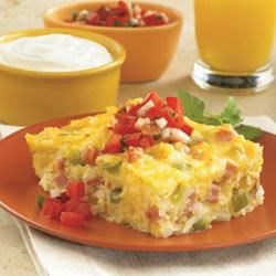 Hashbrown Breakfast Bake Recipe - Hashbrowns, ham, green pepper, sour cream, and eggs all bake to a golden brown, then are topped with pico de gallo and a dollop of Daisy.