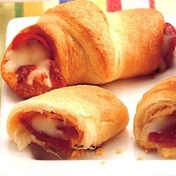 Pepperoni 'n Cheese Crescents Recipe - Four-ingredient pizza roll-ups are ready for snacking or lunchtime in half an hour.