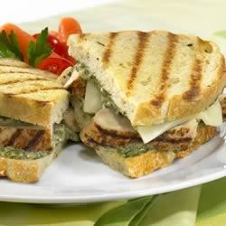 Grilled Chicken Panini Recipe - Simple ingredients make for big flavor in this grilled chicken panini with pesto and provolone cheese.