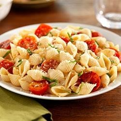 Shells with Cherry Tomatoes, Basil and Parmigiano-Reggiano Cheese Recipe - The simplicity of Italian flavors like basil and cherry tomato comes through in this healthy, easy pasta dish.  Barilla White Fiber pasta adds a boost of fiber but looks and taste like your regular pasta.
