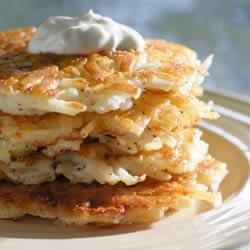 Potato Latkes from Simply Potatoes(R) Recipe - Latkes are a traditional Jewish pancake made with shredded potatoes and eggs. One recommended way to serve latkes is to top them with applesauce.