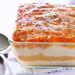Mashed Potato Layer Bake Recipe - Layers of creamy, cheesy mashed potatoes are baked together for a sublime side dish that is sure to please.