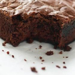 Melt In Your Mouth Brownies Recipe - Moist, chocolate-y brownies are sprinkled with chocolate chips or chopped nuts. Created by Sarah Phillips.