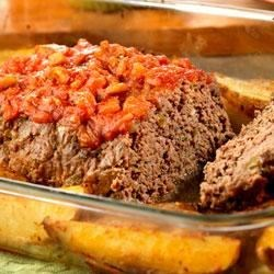 Meatloaf with Roasted Garlic Potatoes Recipe - Ordinary meatloaf becomes extraordinary when it's made with picante instead of tomato sauce.  Served with roasted garlic potatoes, this dish is irresistible.