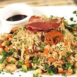 Rice with Goodies Recipe - This dish is a great way to use up leftover turkey. All sorts of goodies - sweet and savory - are tossed together with bacon, turkey and rice to create a wild flavor sensation. Get creative and add your own goodies!