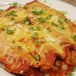 Chili Potato Burritos Recipe - You can use any kind of chili pepper you like - I like poblano or chipotle the best. Buy them dried and put them in your blender to make powder!  Serve warm with a dollop of sour cream if desired. You can substitute taco sauce for enchilada sauce.