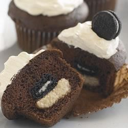 Mini OREO Surprise Cupcakes Recipe - We love cupcakes – and surprises. Each of these chocolate cupcakes comes with a hidden cookie surprise. But, shh... you didn't hear it from us.