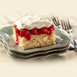 Cherry Vanilla Crush Cake Recipe - Baked meringue is topped with sweet cherry pie filling and covered with whipped topping. This make-ahead dessert is perfect for your next dinner party or potluck.