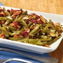 Toasted Almond Green Beans Recipe - Slivered almonds, lemon, and cumin bring their bright flavors to this quick and delicious green bean side dish.