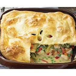 Gram's Chicken Pot Pie Updated Recipe - Comfort food at its finest--this chicken pot pie with a puff pastry crust is full of vegetables, chunks of chicken and shredded Cheddar cheese; and it's on the table in no time.