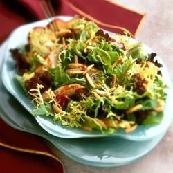 Asian Chicken Almond Salad Recipe - Mixed greens are tossed in a homemade plum sauce dressing and served with tender bites of chicken breast in this Asian-inspired salad.