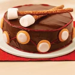Drummer Boy Cake Recipe - Make a cute chocolate cake drum with drumsticks for someone's special celebration.