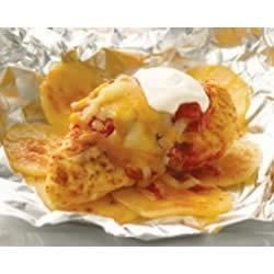 Foil-Pack Taco Chicken Dinner Recipe - Individual foil packets of seasoned chicken, potatoes and cheese are fun to eat and a breeze to clean up.