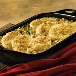 Broccoli Cheese Chicken and Stuffing Recipe - Herb stuffing is baked with chicken breasts and topped with a creamy sauce for this quick and easy main dish.