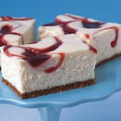 PHILADELPHIA New York-Style Strawberry Swirl Cheesecake Recipe - This delicious creamy cheesecake is baked with a flavorful swirl of strawberry jam, which not only makes it taste fruity, but look sensational, too!