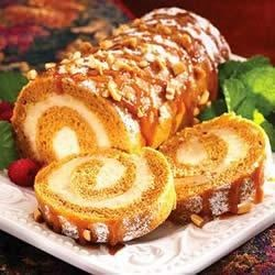 Pumpkin Roll with Crunchy Peanut Butter Cream Recipe - This pumpkin roll is filled with a creamy peanut butter spread, and is topped with a caramel sauce before serving.