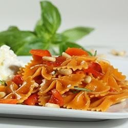 Farfalle with Roasted Red Pepper and Pine Nuts Served with Ricotta and Fresh Mozzarella Recipe - You'll love the bright colors and variety of textures in this delicious pasta dish. Barilla Veggie pasta is made with squash and carrots for an additional veggie boost