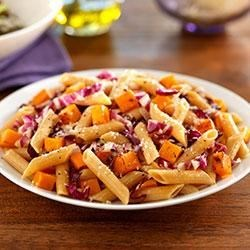 Winter Vegetables over Penne Pasta Recipe - This simple, healthy recipe features seasonal winter vegetables and Barilla Whole Grain Penne. Use precut butternut squash in this recipe to make prep even easier.