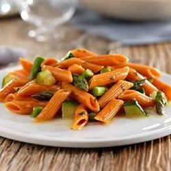 Penne with Zucchini, Asparagus and Parmigiano Reggiano Cheese Recipe - This healthy, satisfying dish uses green veggies and Barilla Veggie Penne pasta, which is made with tomato and carrots for an additional veggie boost.
