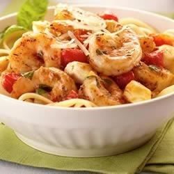 Italian Shrimp Caprese Pasta Recipe - This colorful pasta dish is full of flavor and can be made in less than 30 minutes.