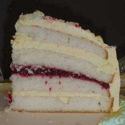 Lemon Raspberry White Chocolate Mousse Cake Recipe - A 4 layer lemon cake made from a mix, with raspberry filling and white chocolate mousse.