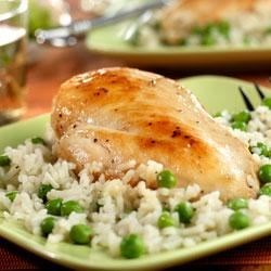 Chicken with Savory Herbed Rice Recipe - If you're looking for a quick-cooking dish that's got lots of great flavor, try this savory saute featuring golden chicken, peas, thyme-seasoned rice and Parmesan cheese.
