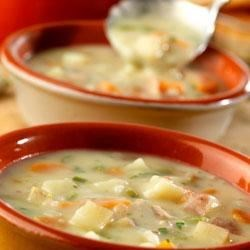 Garlic Potato Soup Recipe - Heart warming and hearty, this bacon-flecked savory soup is made with chunks of red potatoes, carrots, onion and celery that simmer in chicken broth with minced garlic.