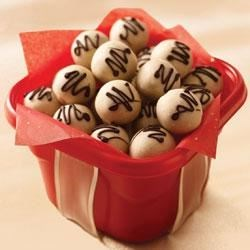 NILLA Tiramisu Cookie Balls Recipe - Coffee-flavored cookie balls are dipped in white chocolate and drizzled with dark chocolate.
