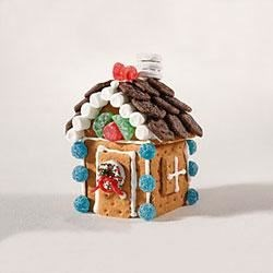Gingerbread Holiday House Recipe - Make your own little gingerbread house using HONEY MAID Gingerbread Grahams and your favorite candy decorations.