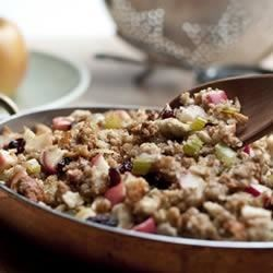 Apple-Raisin Stuffing Recipe - Do you prefer a stuffing that is a little sweet?  Try this exquisite stuffing that balances the savory ingredients with apples, raisins and a touch of cinnamon.