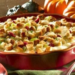 Hellmann's(R) Leftover Turkey Casserole  Recipe - An easy casserole made up of layers of leftover stuffing, turkey, mashed potatoes and cranberry sauce.