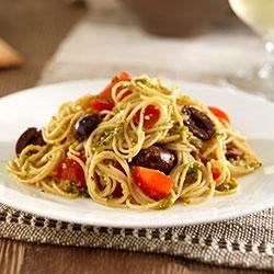 Whole Grain Angel Hair with Pistachio and Basil Pesto, Cherry Tomatoes and Black Olives Recipe - Making delicious pesto is a snap with this crowd-pleasing Whole Grain Pasta recipe.