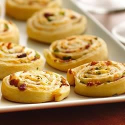 Crescent Bacon-Cheddar Pinwheels Recipe - Ranch dressing perks up a crowd-pleasing, cheesy crescent appetizer.