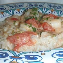 Shrimp in Coconut Tomato Cream Recipe - Shrimp simmered in a creamy citrus, coconut milk, and tomato sauce are served over hot rice in this easy but elegant dinner.