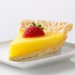 Marshmallow Crispy Lemon Pie Recipe - A crispy, lemon crust is filled with lemon pudding, and garnished with fresh strawberry halves in this pretty and festive dessert.