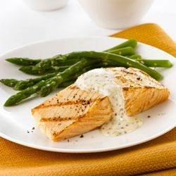 Salmon with Mustard-Cream Sauce Recipe - In this super quick preparation, salmon fillets are brushed with Dijon mustard and quickly grilled, then served with a creamy mustard sauce with herbs and garlic.