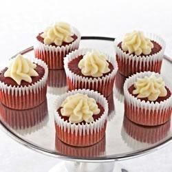 Mini Red Velvet Cupcakes with White Chocolate Mousse Recipe - Mini red velvet cupcakes are filled and topped with creamy white chocolate mousse.