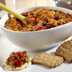 Caponata Appetizer Recipe - Don't be surprised when your guests request this recipe.  Its an easy to make appetizer that combines eggplant, red pepper and garlic to make a mouthwatering spread to serve with crackers or other dippers.
