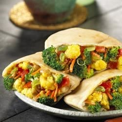 Peanut Vegetable Curry Wraps Recipe - Here's an international-styled vegetarian dish that you can prepare and serve in less than 20 minutes.
