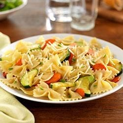 Farfalle with Zucchini, Carrots, Fennel, Marjoram and Parmigiano-Reggiano Cheese Recipe - Fresh veggies--zucchini, carrots, fresh fennel--are tossed with PLUS multigrain pasta, fresh marjoram and grated cheese for a quick and colorful dinner.
