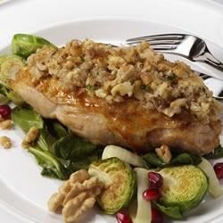 Garlic and Walnut Crusted Chicken Recipe - Change up your chicken routine with this richly flavored chicken dish. Served on top of a bed of spinach, leeks and Brussels sprouts, this is a very nutrient-rich dish!