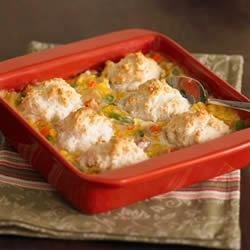 Chicken and Biscuits Recipe - Pair this creamy chicken and biscuit casserole with a crisp mixed green salad tossed with your favorite dressing.