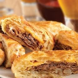 Philly Cheesesteak Rolls Recipe - These upscale cheesesteak sandwiches feature flaky puff pastry instead of ordinary rolls.  They're easy to make, and even easier to enjoy!