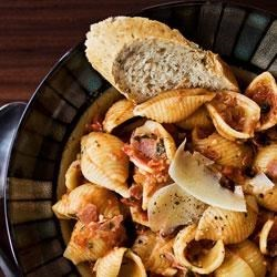 Pasta with Turkey Ham from the LACTAID(R) Brand Recipe - Choose your favorite pasta shape and whip up a winning dish in no time. The rustic sauce of turkey ham, ripe tomatoes and herbs makes this dinner pasta burst with flavor.
