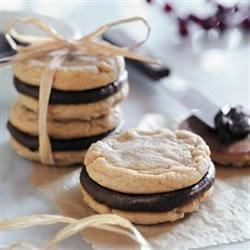 Fudge-Filled Irresistible Peanut Butter Cookies Recipe - Soft, chewy peanut butter cookies are sandwiched together with a layer of fudge--a tried and true flavor combination!