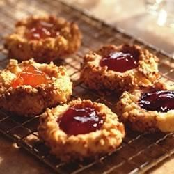 Fruit-Filled Thumbprint Cookies Recipe - Use your favorite flavor Smucker's(R) Orchard's Finest(TM) preserves for these classic thumbprint cookies with pecans.