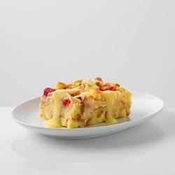 White Choco-Berry Bread Pudding Recipe - A warm and colorful twist on traditional bread pudding with raspberries, white chocolate and almonds.